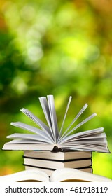 image of stacks of books on green background close up