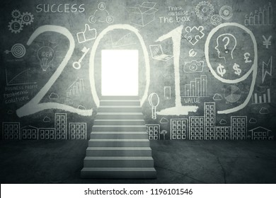 Image of stairway toward shining door with number 2019 and scribbles on the wall