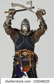 Image of standing knight who is crossing weapon over head