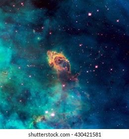Image of a stellar jet in the Carina Nebula, imaged by Hubble's WFC3/UVIS detector. Universe filled with stars, nebula and galaxy. Elements of this image furnished by NASA.