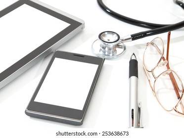 image of stethoscope tablet pen glasses and mobile phone on white background