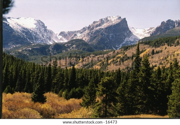 Image of Storm Pass in Colorado. Snow up high, Fall Foliage below.