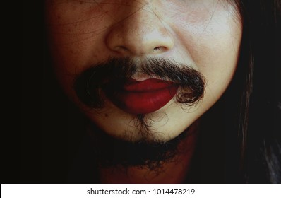 The image of a straight man with mustache and beard put red color lipstick on his lips and look good.The concept of every woman can be beautiful.There are no ugly women, only lazy ones.Stay pretty.