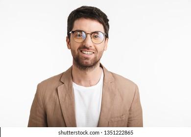 Image of stylish man 30s with stubble wearing jacket and eyeglasses smiling on camera isolated over white background