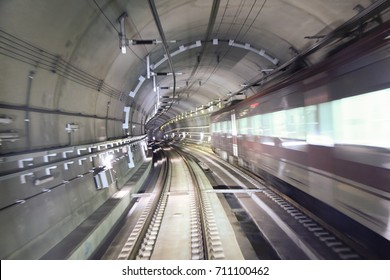 Image of a subway passing through a tunnel - taken at a low speed to give a speed effect