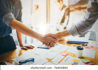 Image of Successful businessmen partnership handshaking after acquisition. Meeting for sign contracts and Group support concept.