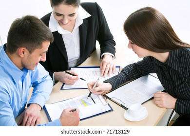 Image of successful partners discussing business plan