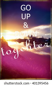 Image from a sunset with the saying > GO UP & DOWN togehter<.