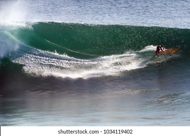 Image of Surfer on Blue Ocean Big Mavericks Wave in California, USA. Surfer riding and make fast turn. Gun surfboard.