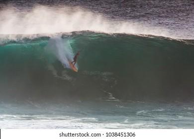 Image of Surfer on Blue Ocean Big Mavericks Wave in California, USA. Surfer riding in tube. Gun surfboard.