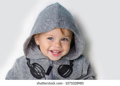 Image of  sweet baby boy, closeup portrait of child, cute toddler with blue eyes.