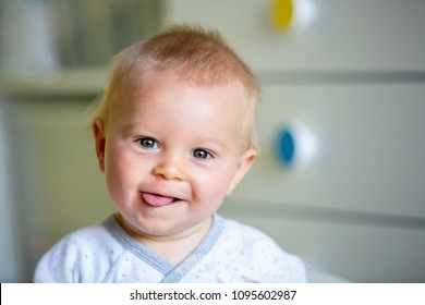 Image of sweet baby boy, closeup portrait of child, cute toddler with blue eyes, indoors shot