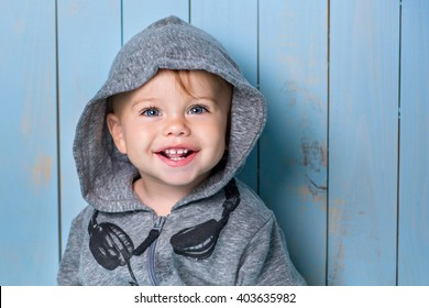 Image of  sweet baby boy, closeup portrait of child, cute toddler with blue eyes