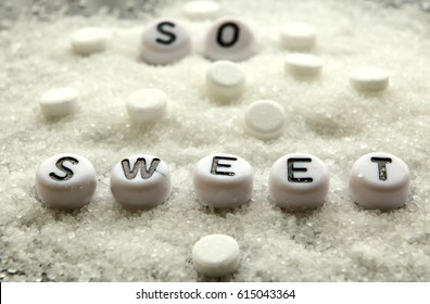 "Image of  "" so sweet "" words with refined white sugar and sweetener tablets."