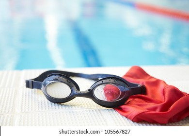 Image of swimming pool, goggles and swimming hat. Nobody