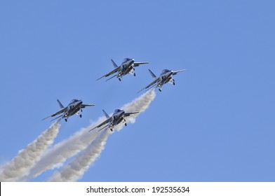 An image of T-4 Blue Impulse formation