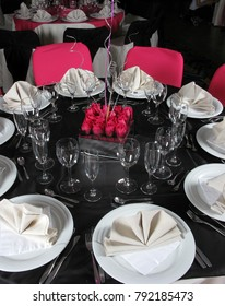An image of a table setting at a luxury wedding reception.