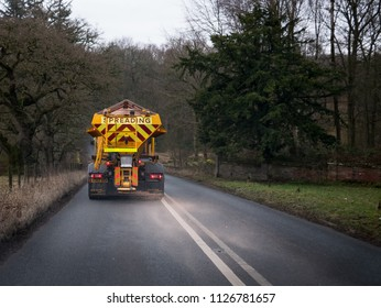 Image taken 23rd October 2017 in Oxford UK. Colour image of a orange grit machine treating a single carriageway before bad weather arrives.