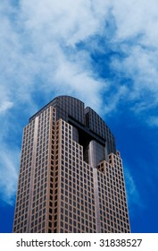 Image of a tall skyscraper on a blue sky background
