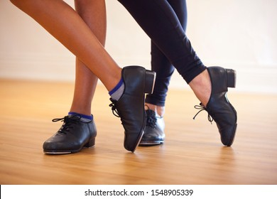 Image of tap shoes from a tap dance class in a dance studio. - Shutterstock ID 1548905339