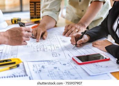 Image of team engineer checks construction blueprints on new project with engineering tools at desk in office.
