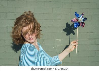Image of a teenage girl holding pinwheel