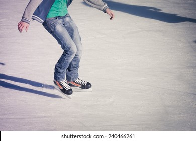 Image of teenager who are ice skating in the ice rink at the Medeo
