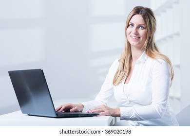 Image of tele consultant with laptop during work