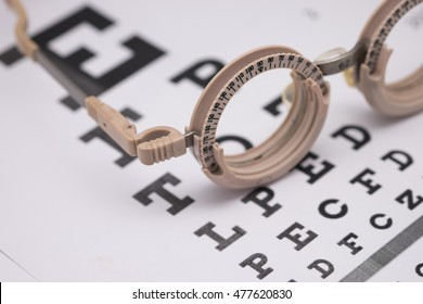 Image of test glasses with letter chart for eyes examination, sight vision optometry background