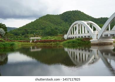 image of The Tha Chomphu Railway Bridge or White Bridge, railway bridge in Mae Tha District, Lamphun, history landmark of Thailand