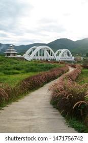 image of The Tha Chomphu Railway Bridge or White Bridge , railway bridge in Mae Tha District, Lamphun, history landmark of the northern of Thailand