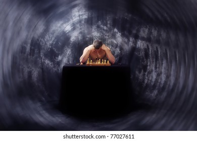 Image of thinking man, playing a chess