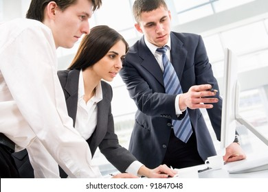 Image of three business people working at meeting