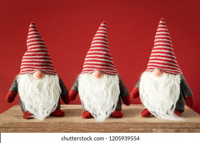 An image of three Christmas gnomes with white beards