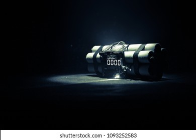 Image of a time bomb against dark background. Timer counting down to detonation illuminated in a shaft light shining through the darkness, conceptual image