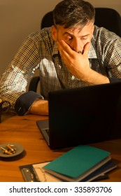 Image of tired busy male working on computer