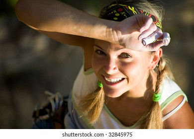 Image of tired sport woman touching her forehead