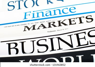 An image of titles of newspapers about the business