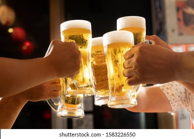 Image of toasting with beer at a tavern