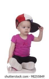 Image of a toddler tom boy wearing a USA baseball hat.