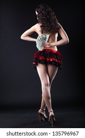 Image of topless flamenco dancer with dollars