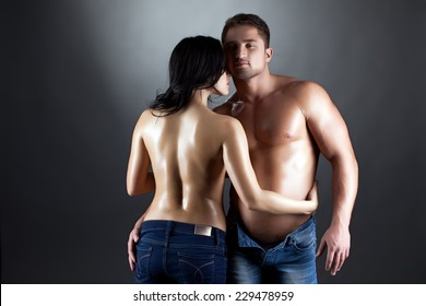 Image of topless lovers embracing at camera