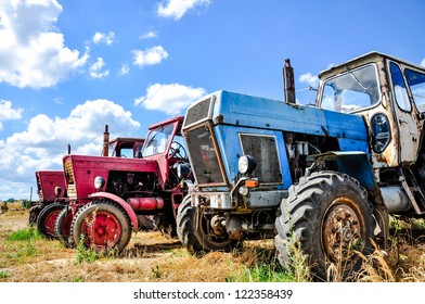 An image of Tractor on the field doing works