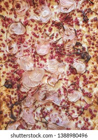 Image of Traditional Tarte flambee with creme fraiche, cheese, onion and bacon. Top down view, Flat lay