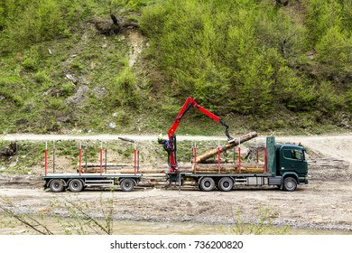 Image of truck loading timber