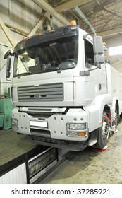The image of a truck under repair