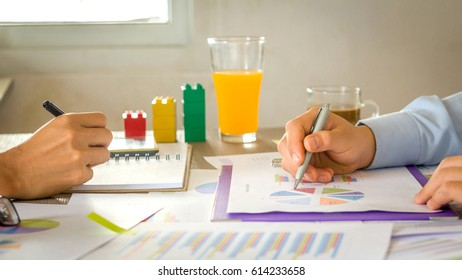 Image of two businessman meeting,team work processing data, in office.