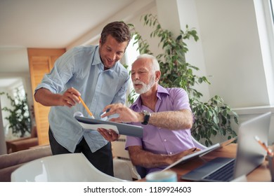 Image of two businessmen discussing about new project in modern office.