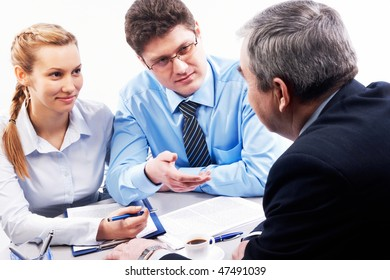 Image of two businesspeople speaking something to their boss