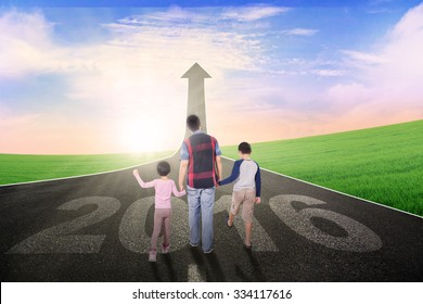 Image of two children and their father, walking on the road together with numbers 2016 and upward arrow